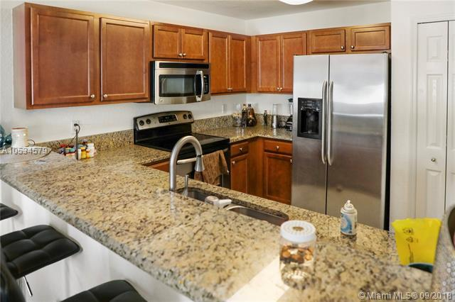 11401 NW 89th St #203, Doral, FL 33178 (MLS #A10534579) :: Prestige Realty Group