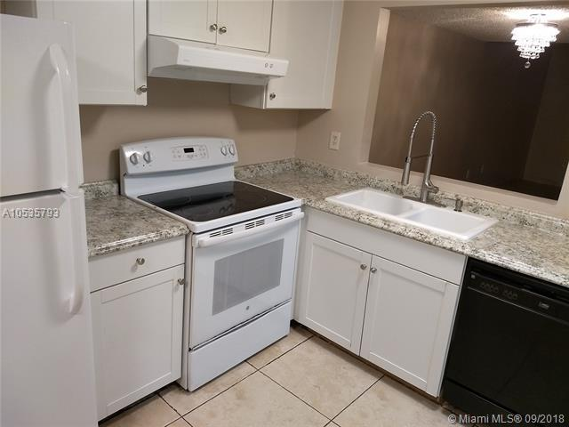 4032 NW 90th Ave #4032, Sunrise, FL 33351 (MLS #A10535793) :: Stanley Rosen Group