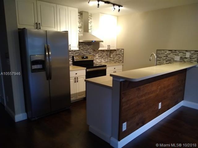 12836 Woodmill Dr #12836, Palm Beach Gardens, FL 33418 (MLS #A10557946) :: Green Realty Properties