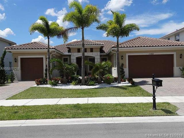 11883 NW 79th Ct, Parkland, FL 33076 (MLS #A10581128) :: United Realty Group