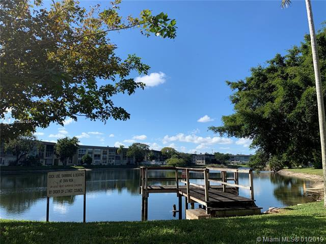 5320 NW 11th St #208, Plantation, FL 33313 (MLS #A10594194) :: The Teri Arbogast Team at Keller Williams Partners SW