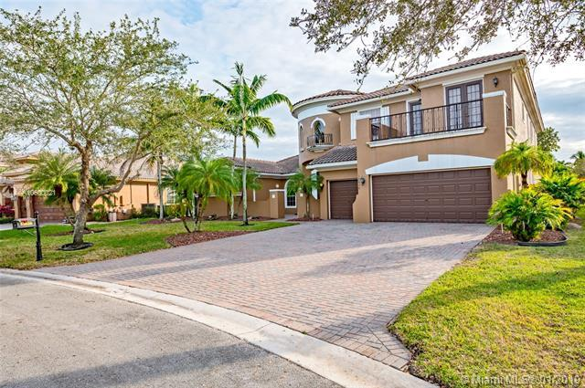 12628 NW 74th Pl, Parkland, FL 33076 (MLS #A10600021) :: The Chenore Real Estate Group