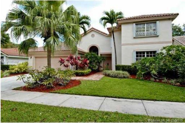 1930 Lake Point Dr, Weston, FL 33326 (MLS #A10614894) :: The Teri Arbogast Team at Keller Williams Partners SW