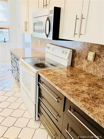 1300 Saint Charles Pl #405, Pembroke Pines, FL 33026 (MLS #A10621096) :: Castelli Real Estate Services