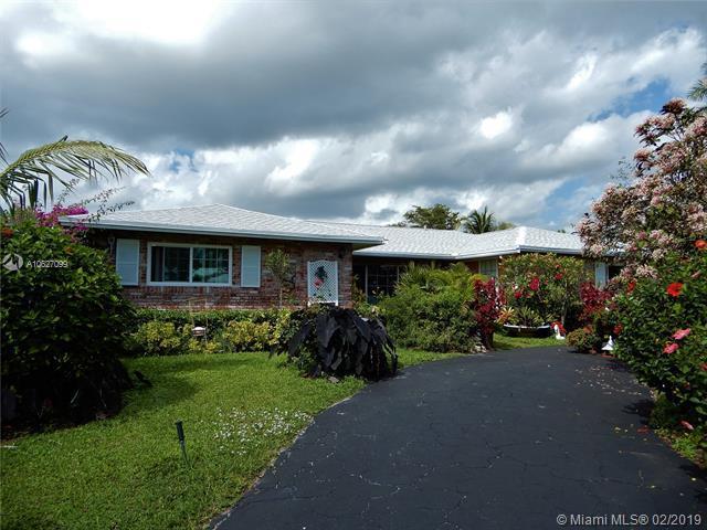 1139 E Tropical Way, Plantation, FL 33317 (MLS #A10627099) :: The Teri Arbogast Team at Keller Williams Partners SW