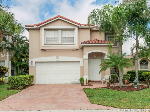 5374 NW 126th Dr, Coral Springs, FL 33076 (MLS #A10627284) :: The Teri Arbogast Team at Keller Williams Partners SW