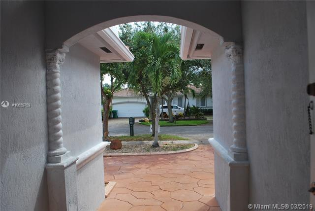 16324 NW 77th Path, Miami Lakes, FL 33016 (MLS #A10639759) :: EWM Realty International