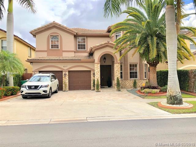 8317 NW 115th Ct, Doral, FL 33178 (MLS #A10646637) :: The Paiz Group