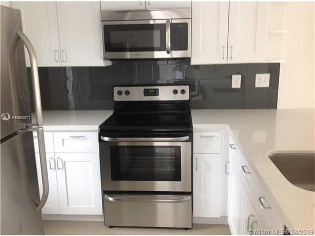 5041 W Oakland Park Blvd #201, Lauderdale Lakes, FL 33313 (MLS #A10664071) :: Green Realty Properties