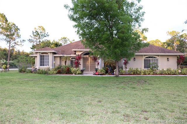 8256 Apache Blvd, Loxahatchee, FL 33470 (MLS #A10667127) :: RE/MAX Presidential Real Estate Group