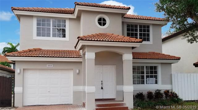 8565 NW 196th Ter, Hialeah, FL 33015 (MLS #A10677257) :: The Maria Murdock Group