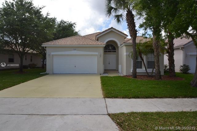 2129 NW 49th Ave, Coconut Creek, FL 33063 (MLS #A10683308) :: The Teri Arbogast Team at Keller Williams Partners SW