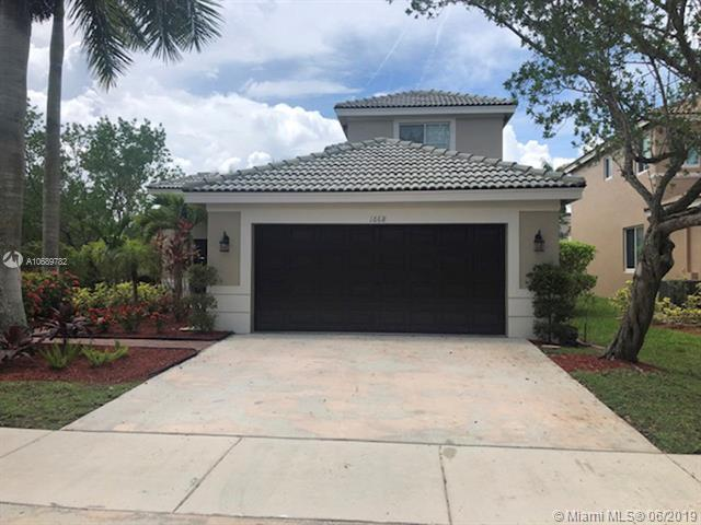 1668 Winterberry Ln, Weston, FL 33327 (MLS #A10689782) :: The Teri Arbogast Team at Keller Williams Partners SW