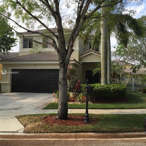1145 Golden Cane Dr, Weston, FL 33327 (MLS #A10690003) :: The Teri Arbogast Team at Keller Williams Partners SW