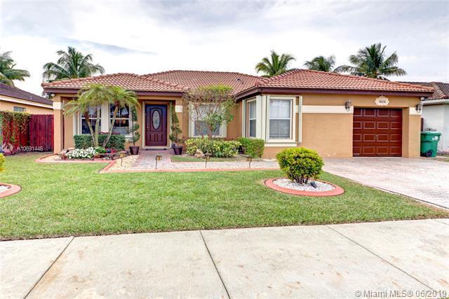 14214 SW 163rd Ter, Miami, FL 33177 (MLS #A10691446) :: EWM Realty International