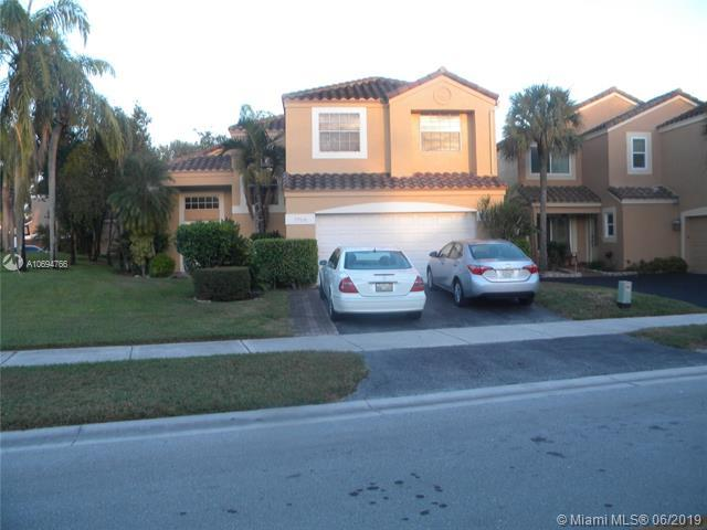 7710 NW 62nd Way, Parkland, FL 33067 (MLS #A10694766) :: The Brickell Scoop
