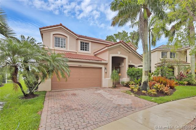 1098 Lavender Cir, Weston, FL 33327 (MLS #A10698054) :: The Teri Arbogast Team at Keller Williams Partners SW
