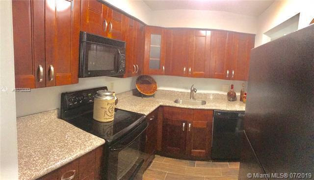 501 SE 8th St #107, Deerfield Beach, FL 33441 (MLS #A10700332) :: Berkshire Hathaway HomeServices EWM Realty