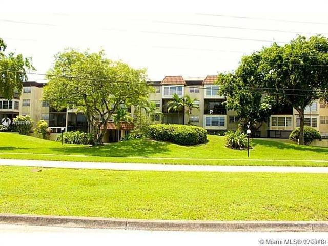 7100 NW 17th St #419, Plantation, FL 33313 (MLS #A10705188) :: The Teri Arbogast Team at Keller Williams Partners SW