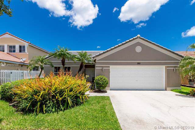 393 Carrington Dr, Weston, FL 33326 (MLS #A10707330) :: The Teri Arbogast Team at Keller Williams Partners SW