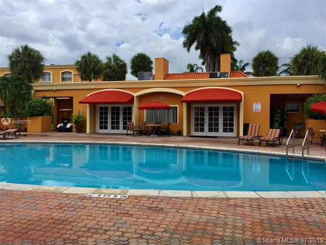 18111 NW 68th Ave F105, Hialeah, FL 33015 (MLS #A10707770) :: Berkshire Hathaway HomeServices EWM Realty