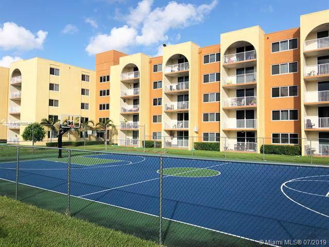 7010 NW 186th St 5-314, Hialeah, FL 33015 (MLS #A10708548) :: Berkshire Hathaway HomeServices EWM Realty
