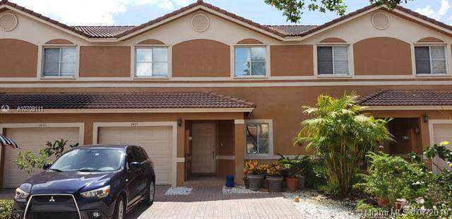 2475 NW 98th Ln, Sunrise, FL 33322 (MLS #A10709111) :: The Jack Coden Group
