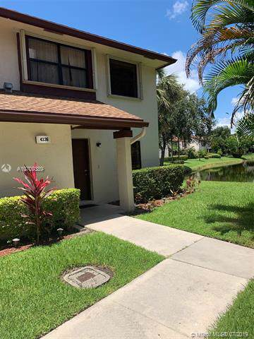 4336 N Carambola Cir N, Coconut Creek, FL 33066 (MLS #A10709389) :: Berkshire Hathaway HomeServices EWM Realty