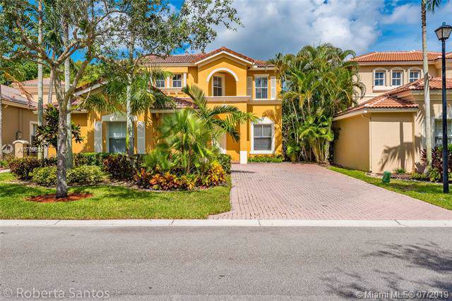 5887 NW 119th Dr, Coral Springs, FL 33076 (MLS #A10709813) :: Grove Properties