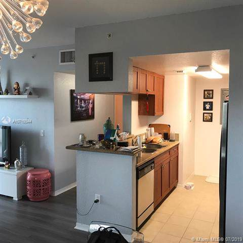 36 NW 6th Ave #406, Miami, FL 33128 (MLS #A10710044) :: The Teri Arbogast Team at Keller Williams Partners SW