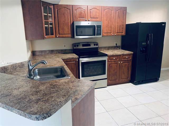 9033 Wiles Rd #202, Coral Springs, FL 33067 (MLS #A10710052) :: Grove Properties