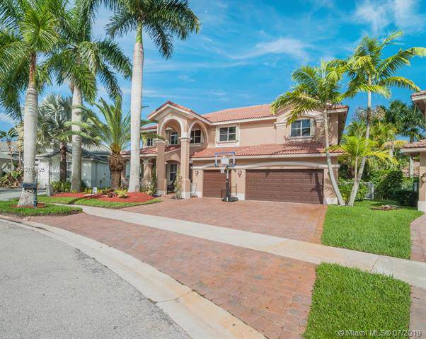 1879 Hidden Trail Ln, Weston, FL 33327 (MLS #A10710795) :: The Teri Arbogast Team at Keller Williams Partners SW