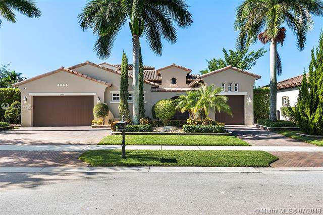 12212 NW 72nd St, Parkland, FL 33076 (MLS #A10711127) :: The Jack Coden Group