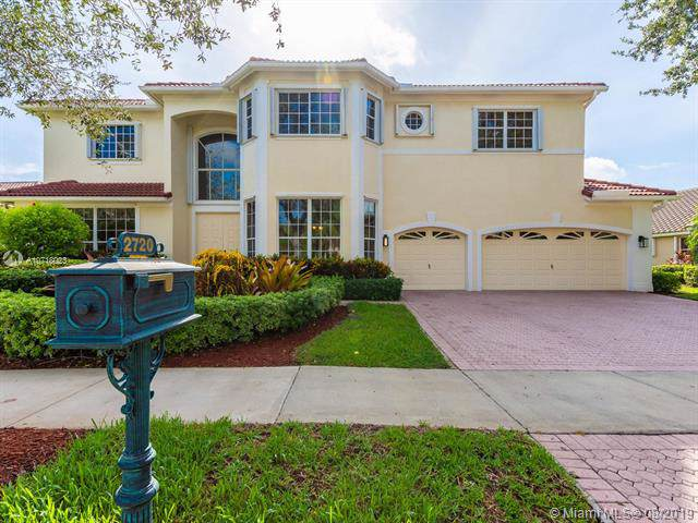 2720 Meadowood Drive, Weston, FL 33332 (MLS #A10718023) :: Berkshire Hathaway HomeServices EWM Realty