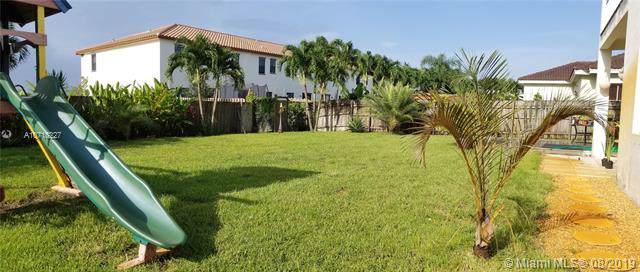 9107 NW 182nd Ter, Hialeah, FL 33018 (MLS #A10718227) :: Grove Properties