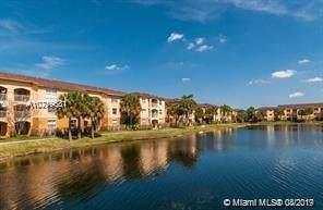 9615 NW 1st Ct 10-106, Pembroke Pines, FL 33024 (MLS #A10719681) :: The Teri Arbogast Team at Keller Williams Partners SW