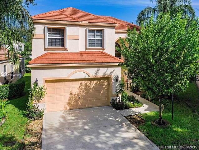 8037 NW 66th Ter, Parkland, FL 33067 (MLS #A10720084) :: Grove Properties