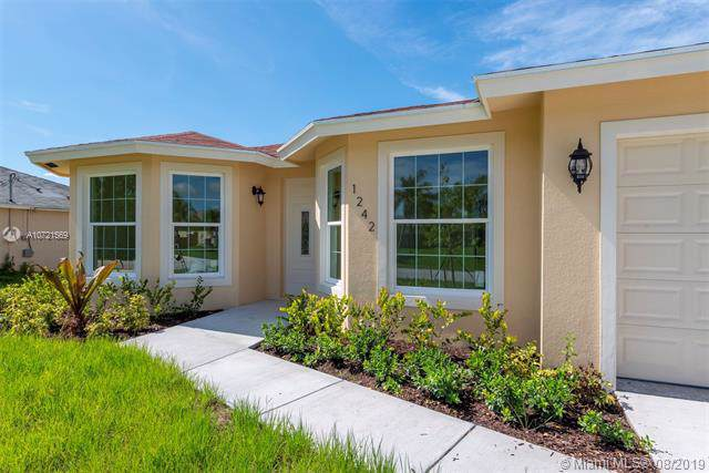 1242 SW Santiago Ave, Port Saint Lucie, FL 34953 (MLS #A10721569) :: GK Realty Group LLC