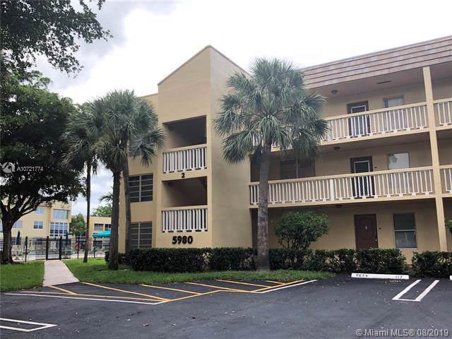5980 NW 64th Ave #201, Tamarac, FL 33319 (MLS #A10721774) :: The Edge Group at Keller Williams