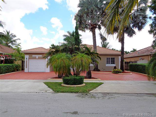 16751 NW 89th Pl, Miami Lakes, FL 33018 (MLS #A10724459) :: Albert Garcia Team