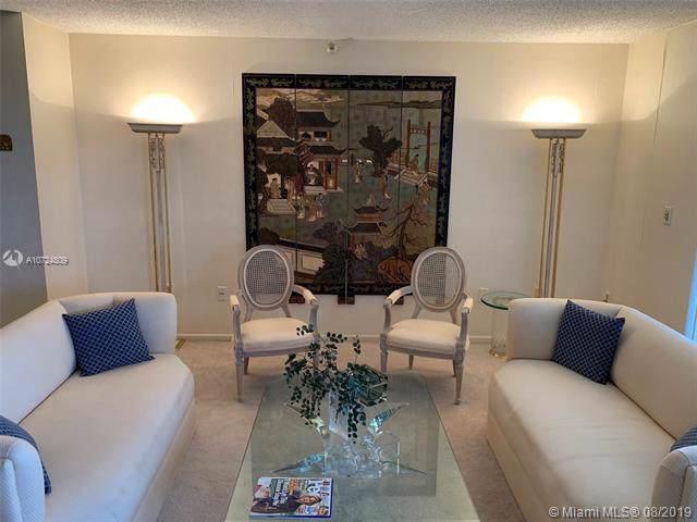 900 NE 195th St #401, Miami, FL 33179 (MLS #A10724809) :: Lucido Global
