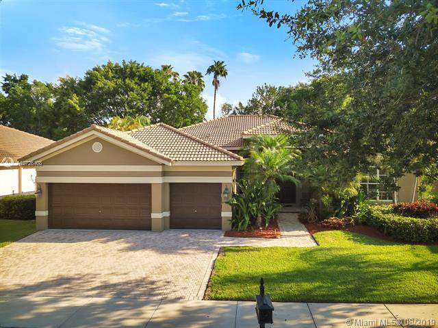 3943 Nighthawk Dr, Weston, FL 33331 (MLS #A10726408) :: The Teri Arbogast Team at Keller Williams Partners SW