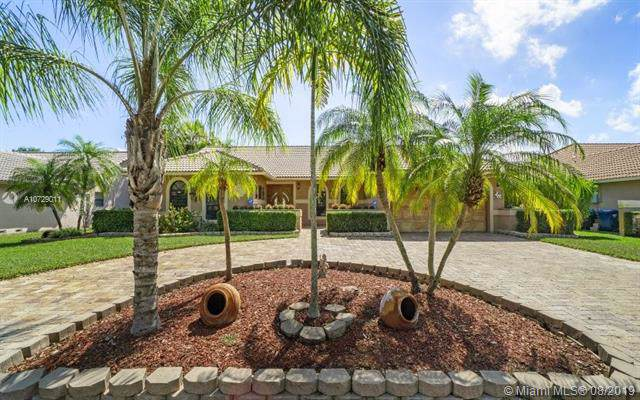 8640 NW 50th Dr, Coral Springs, FL 33067 (MLS #A10729011) :: Patty Accorto Team