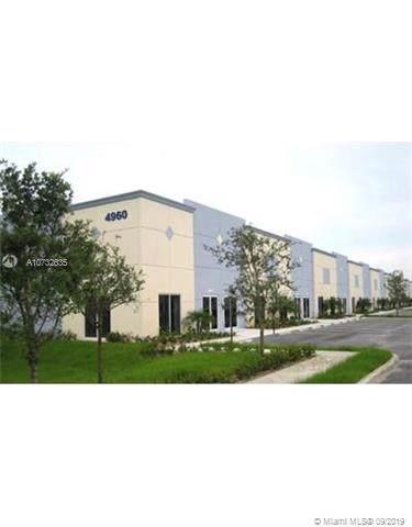4980 NW 165th St A15, Miami Gardens, FL 33014 (MLS #A10732635) :: The Kurz Team
