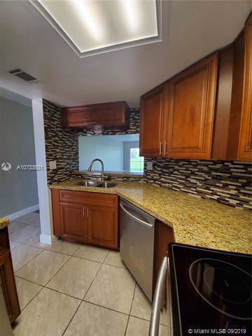 2803 N Course Dr #101, Pompano Beach, FL 33069 (MLS #A10733601) :: Ray De Leon with One Sotheby's International Realty