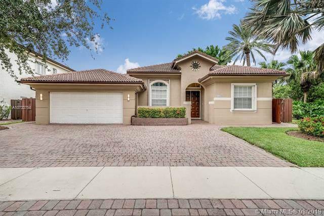 11133 NW 71st Terrace, Doral, FL 33178 (MLS #A10733754) :: The Kurz Team