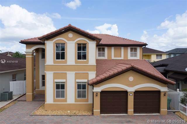 8869 NW 179 LN, Hialeah, FL 33018 (MLS #A10740108) :: Grove Properties