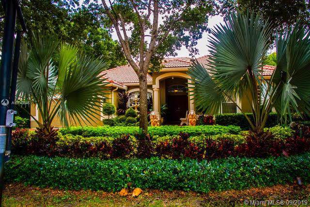 6404 NW 43rd Ter, Coconut Creek, FL 33073 (MLS #A10743546) :: United Realty Group