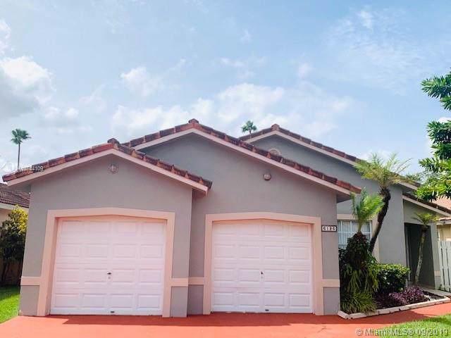 6126 NW 181st Terr Cir W, Hialeah, FL 33015 (MLS #A10744109) :: Grove Properties