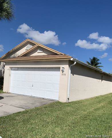 1438 Red Apple Ln, West Palm Beach, FL 33415 (MLS #A10749888) :: Berkshire Hathaway HomeServices EWM Realty